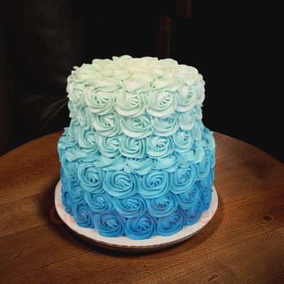 blue anniversary cake with flowers