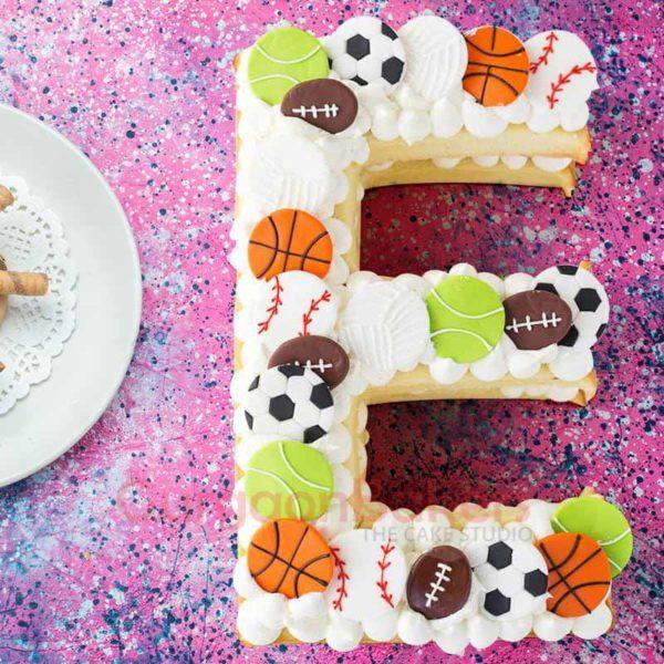 naked alphabet cookie cake