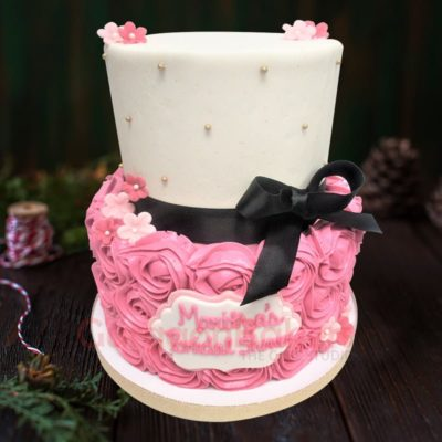 pink and black two tiers birthday cake